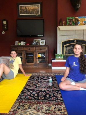 Two girls on zoom doing camp abilities virtually